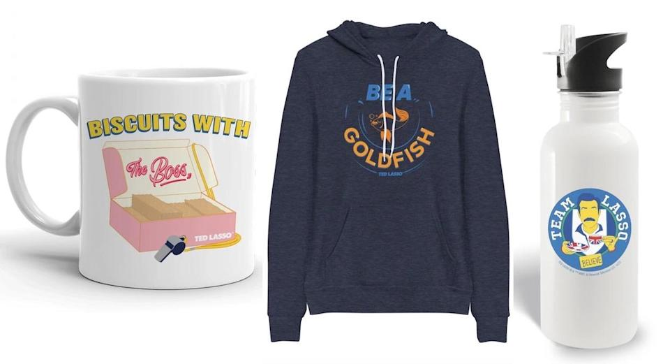 A mug, sweatshirt, and water bottle for Ted Lasso
