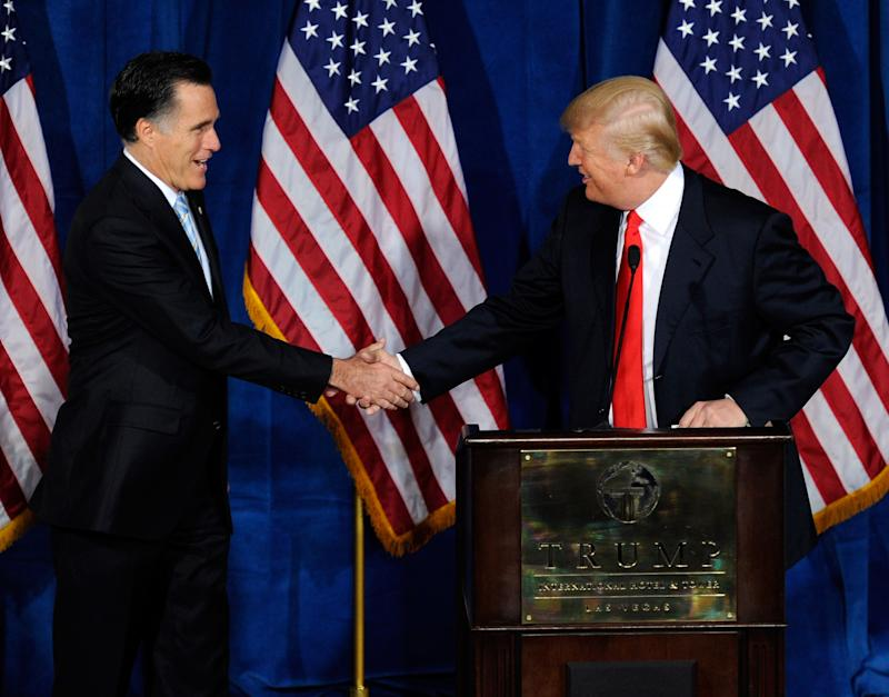Republican presidential candidate, former Massachusetts Gov. Mitt Romney (L) and Donald Trump shake hands during a news conference held by Trump to endorse Romney for president at the Trump International Hotel & Tower Las Vegas February 2, 2012 in Las Vegas, Nevada.
