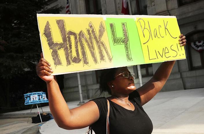 <p>A small group of Black Lives Matters supporters walk through downtown before the start of the Democratic National Convention (DNC) on July 24, 2016 in Philadelphia, Pennsylvania. (Spencer Platt/Getty Images)</p>