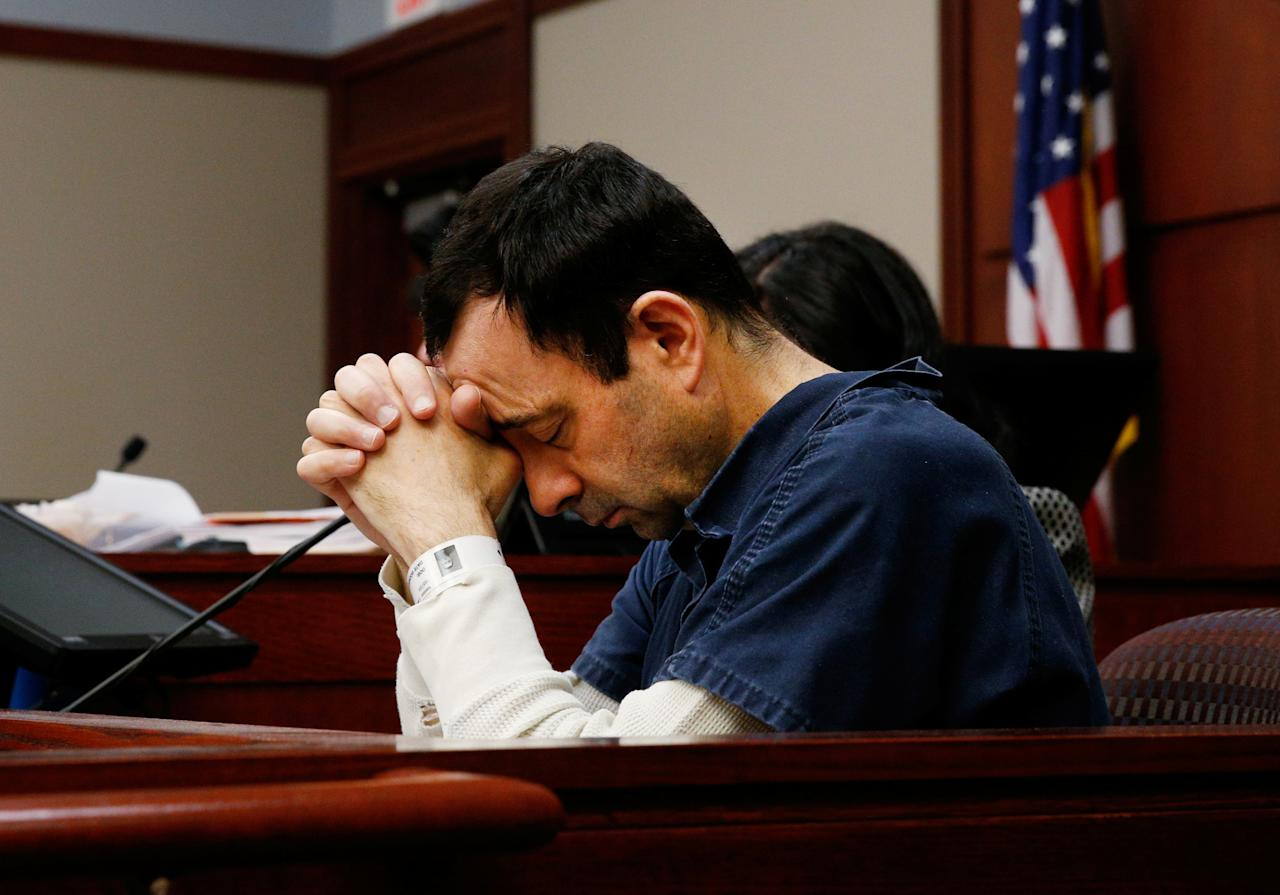 Dr. Larry Nassar, a former team USA Gymnastics doctor who pleaded guilty in November 2017 to sexual assault charges, listens to a victim during his sentencing hearing in Lansing, Michigan, U.S., January 16, 2018.    REUTERS/Brendan McDermid?