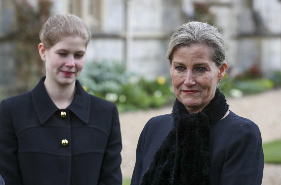 Britain's Sophie, Countess of Wessex, (R) and her daughter Britain's Lady Louise Windsor (L) talk to Crown Estate staff as she attends Sunday service at the Royal Chapel of All Saints, at Royal Lodge, in Windsor on April 11, 2021, two days after the death of Britain's Prince Philip, Duke of Edinburgh. - Queen Elizabeth II has described feeling a