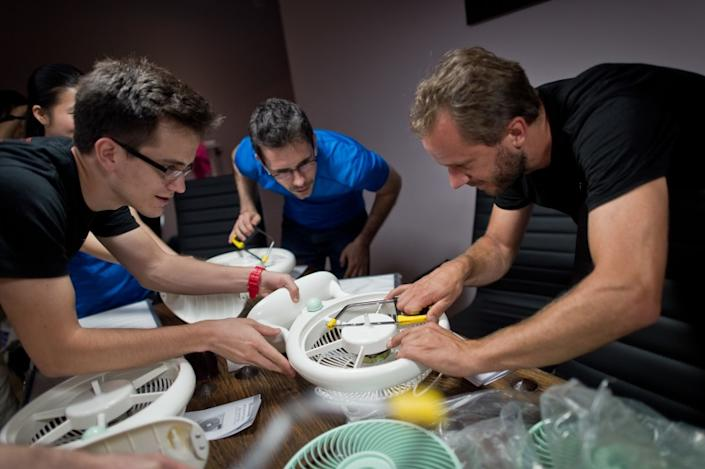 Thomas Talhelm, center, founder of Smart Air, led workshops when he was living in Beijing to demonstrate how to make a simple DIY air purifier that would protect users from breathing in dangerous particulate matter when there was poor air quality.