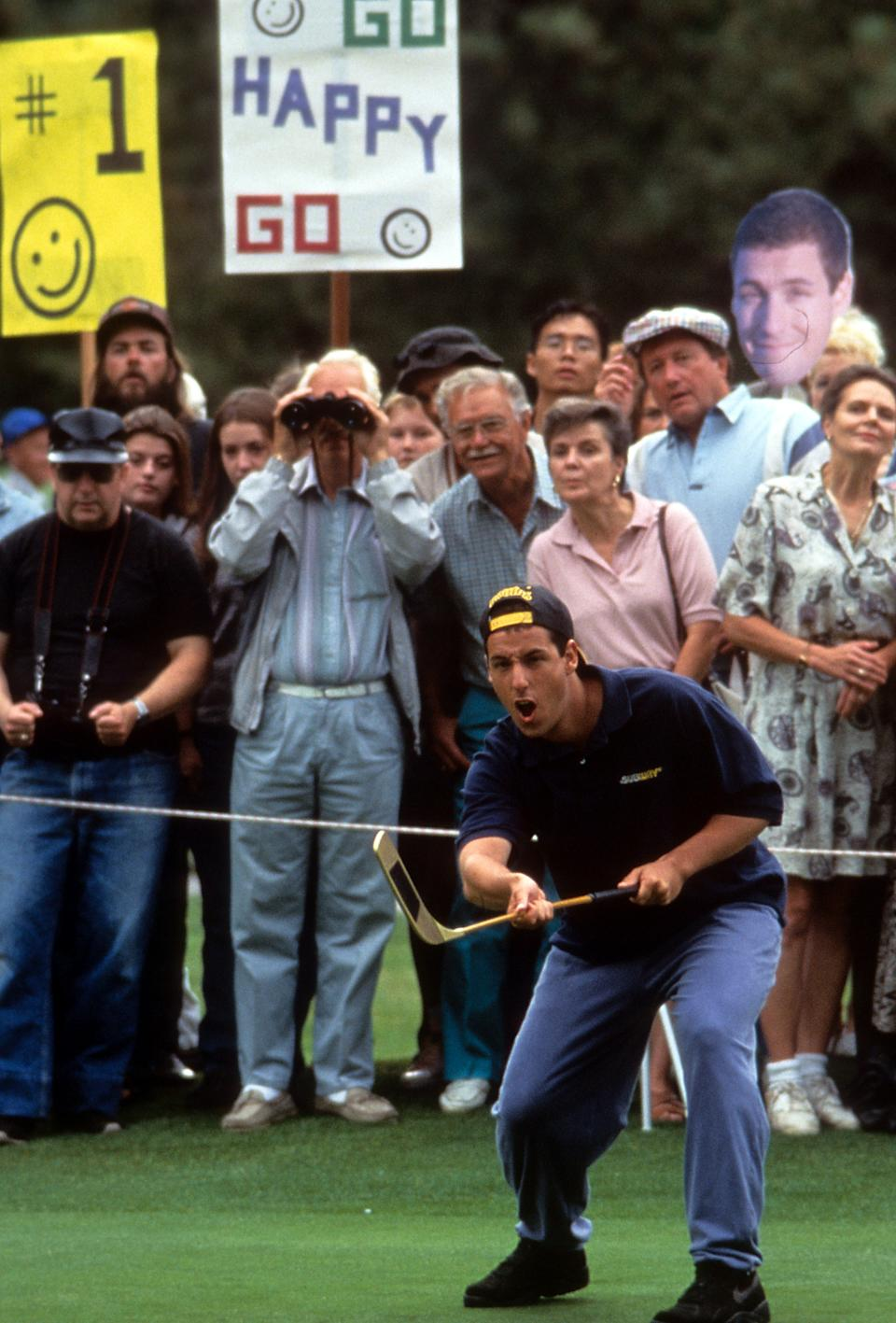 Adam Sandler plays golf in a scene from the film 'Happy Gilmore', 1996. (Photo by Universal/Getty Images)