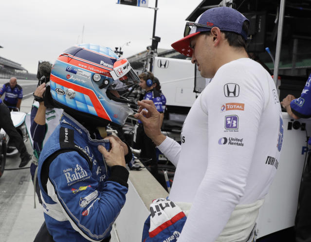 Graham Rahal, right, talks with Takuma Sato, of Japan, during a practice session for the IndyCar Indianapolis 500 auto race at Indianapolis Motor Speedway in Indianapolis Friday, May 18, 2018. (AP Photo/Darron Cummings)