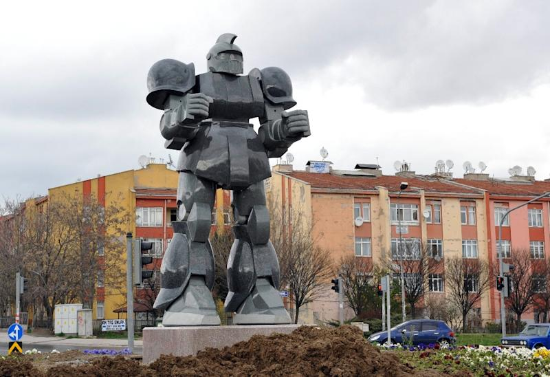 A robot statue stands on April 2, 2015 near Turkey's new presidential palace in Ankara, erected by the city Mayor Melih Gokcek