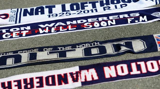 A football scarf with a message of support is left at the stadium's Book of Remembrance at The Reebok Stadium in Bolton, north-west England on March 18, 2012 the morning after Bolton Wanderers' English midfielder Fabrice Muamba collapsed during their FA cup football match against Tottenham Hotspur in London. Muamba remains in 'critical condition' according to the hospital. (Photo by Paul Ellis/AFP/Getty Images)