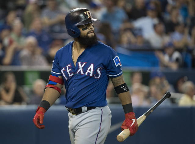 Texas Rangers second baseman Rougned Odor looks back after striking out against the Toronto Blue Jays during the sixth inning of a baseball game, Tuesday Aug. 13, 2019 in Toronto. (Nathan Denette/The Canadian Press via AP)