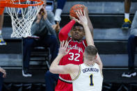Ohio State forward E.J. Liddell (32) shoots over Michigan center Hunter Dickinson (1) in the first half of an NCAA college basketball game at the Big Ten Conference tournament in Indianapolis, Saturday, March 13, 2021. (AP Photo/Michael Conroy)