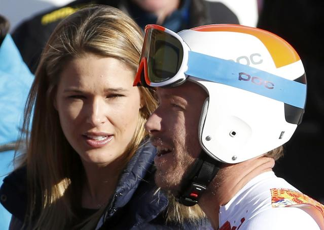 Bode Miller (R) of the U.S. stands next to his wife Morgan Beck after finishing the downhill run of the men's alpine skiing super combined event during the 2014 Sochi Winter Olympics at the Rosa Khutor Alpine Center in Rosa Khutor February 14, 2014. REUTERS/Leonhard Foeger (RUSSIA - Tags: OLYMPICS SPORT SKIING)