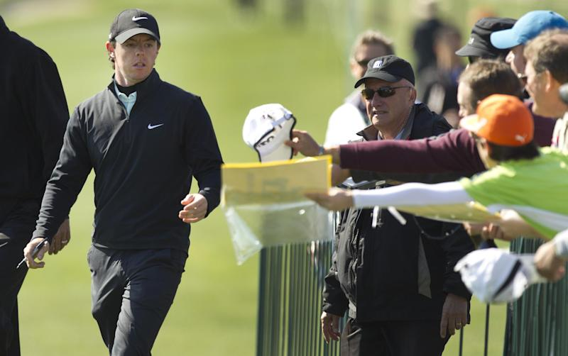 Rory McIlroy walks past autograph-seeking fans as he heads to the first tee during the pro-am for the Houston Open golf tournament, Wednesday, March 27, 2013, in Houston. (AP Photo/Houston Chronicle, Brett Coomer) MANDATORY CREDIT