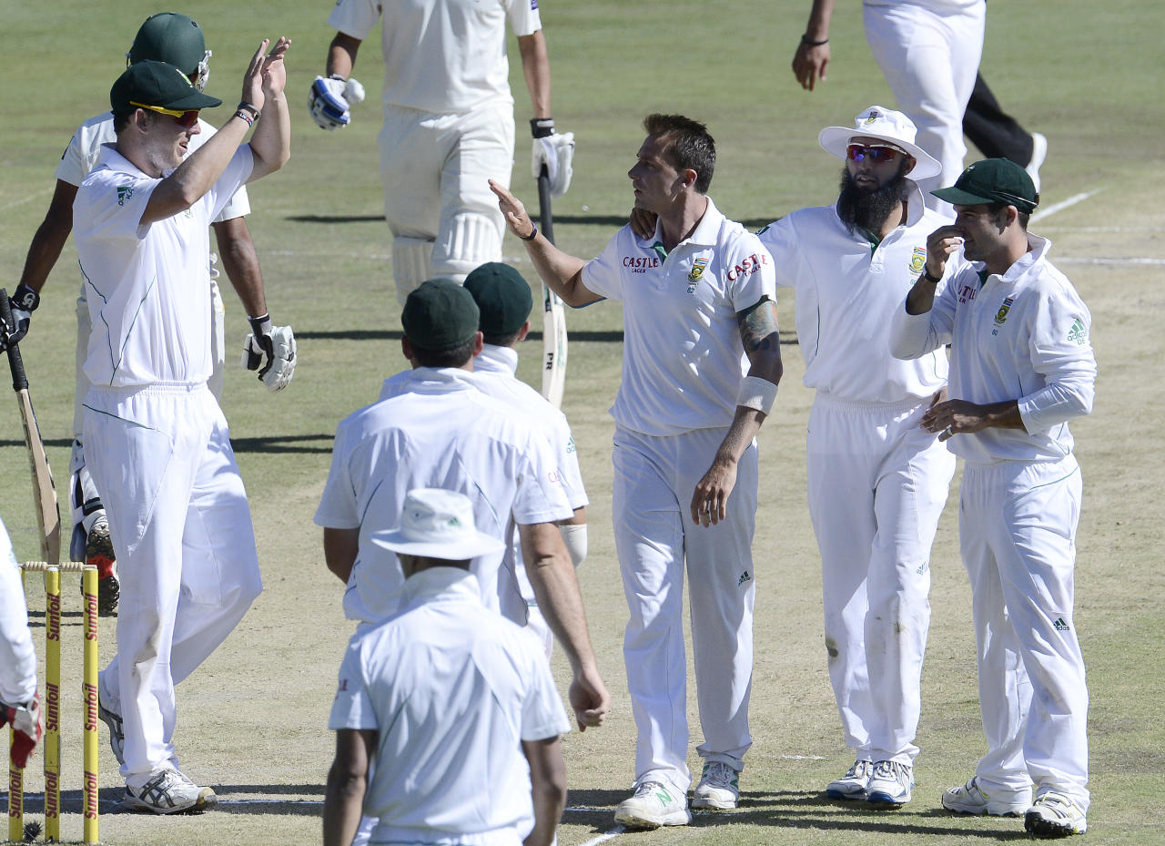 South African bowler Dale Steyn (C) is congratulated by teammates for the dismissal of Pakistan batsman Asad Shafiq during the second day of the third Test match between South Africa and Pakistan on February 23, 2013 at Super Sport Park in Centurion. AFP PHOTO / STEPHANE DE SAKUTIN        (Photo credit should read STEPHANE DE SAKUTIN/AFP/Getty Images)