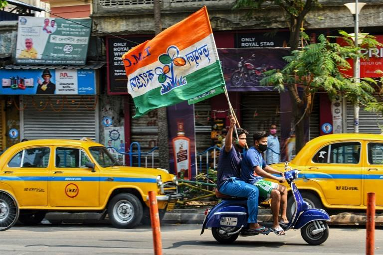 Supporters celebrate the TMC's lead in the West Bengal state elections