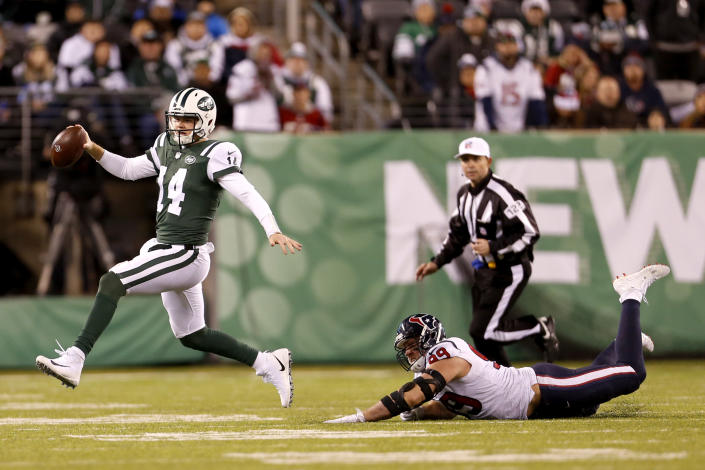 New York Jets quarterback Sam Darnold (14) avoids a hit from Houston Texans defensive end J.J. Watt (99) during the second half of an NFL football game, Saturday, Dec. 15, 2018, in East Rutherford, N.J. (AP Photo/Adam Hunger)