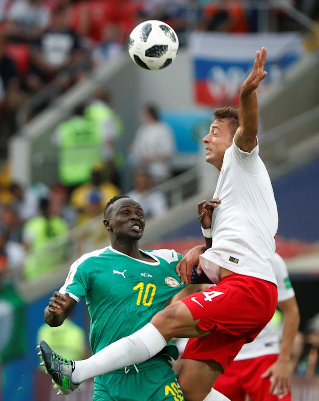 Soccer Football - World Cup - Group H - Poland vs Senegal - Spartak Stadium, Moscow, Russia - June 19, 2018 Poland's Thiago Cionek in action with Senegal's Sadio Mane REUTERS/Grigory Dukor