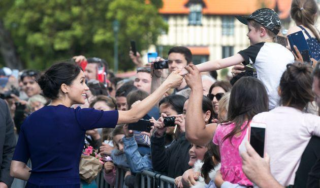 The Duchess of Sussex is used to charming crowds.