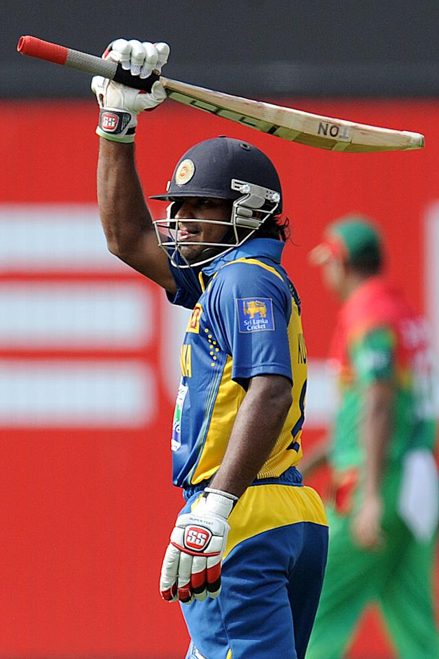 Sri Lankan cricketer Kushal Janith Perera raises his bat to the crowd after scoring a half-century (50 runs) during the third and final one-day international (ODI) match between Sri Lanka and Bangladesh at The  Pallekele International Cricket Stadium in Pallekele on March 28, 2013. AFP PHOTO/ Ishara S. KODIKARA        (Photo credit should read Ishara S.KODIKARA/AFP/Getty Images)