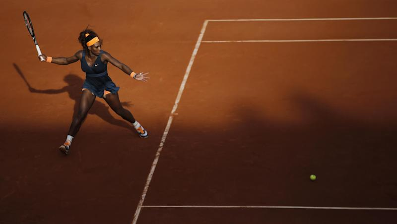 Serena Williams of the U.S. returns in her semifinal match defeating Italy's Sara Errani in two sets 6-0, 6-1, at Roland Garros stadium in Paris, Thursday June 6, 2013. (AP Photo/Christophe Ena)