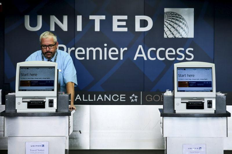 A United Airlines worker checks computers in their counters at the Newark Liberty International Airport in New Jersey