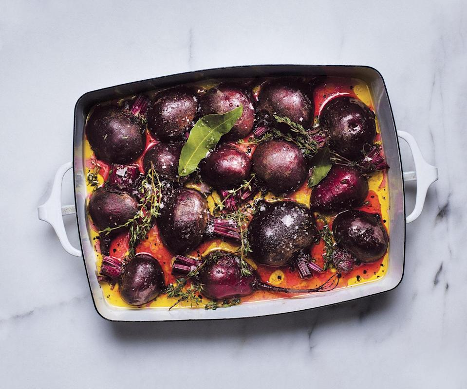 """This steam-roasting method (high heat, covered pan) is the best; the liquid prevents the beets from drying out. <a href=""""https://www.bonappetit.com/recipe/big-batch-of-oven-steamed-beets?mbid=synd_yahoo_rss"""" rel=""""nofollow noopener"""" target=""""_blank"""" data-ylk=""""slk:See recipe."""" class=""""link rapid-noclick-resp"""">See recipe.</a>"""