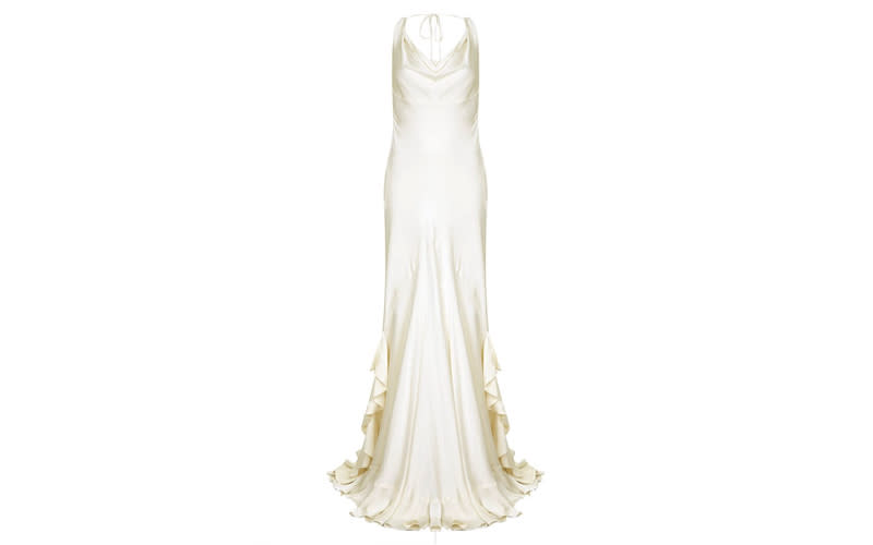 "<p>The cowl neckline is one favoured among the fashion elite this season and will prove an elegant choice for the aisle. Ghost's Willow gown also features a frilled train and silk shoestring tie, a definite choice for understated brides. <a rel=""nofollow"" href=""https://www.ghost.co.uk/willow-dress-chalk-white-dx24ca-c04""><em>Shop now</em></a>. </p>"