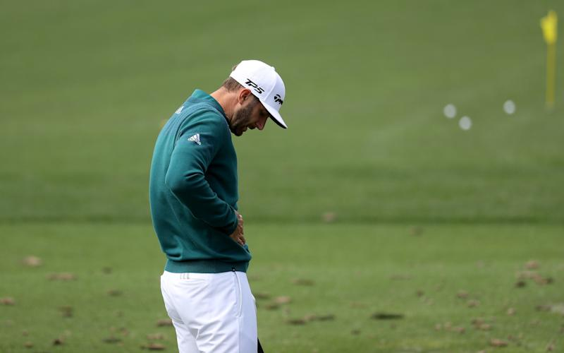Dustin Johnson of the United States practices on the range prior to his tee time - Credit: GETTY