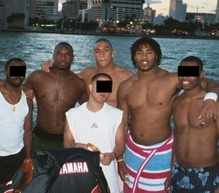 Nevin Shapiro said he took this Biscayne Bay photo on the back of his $1.6 million yacht in the summer of 2003. Pictured from left to right are D.J. Williams, Kellen Winslow Jr. and then-Nebraska defensive end Benard Thomas.