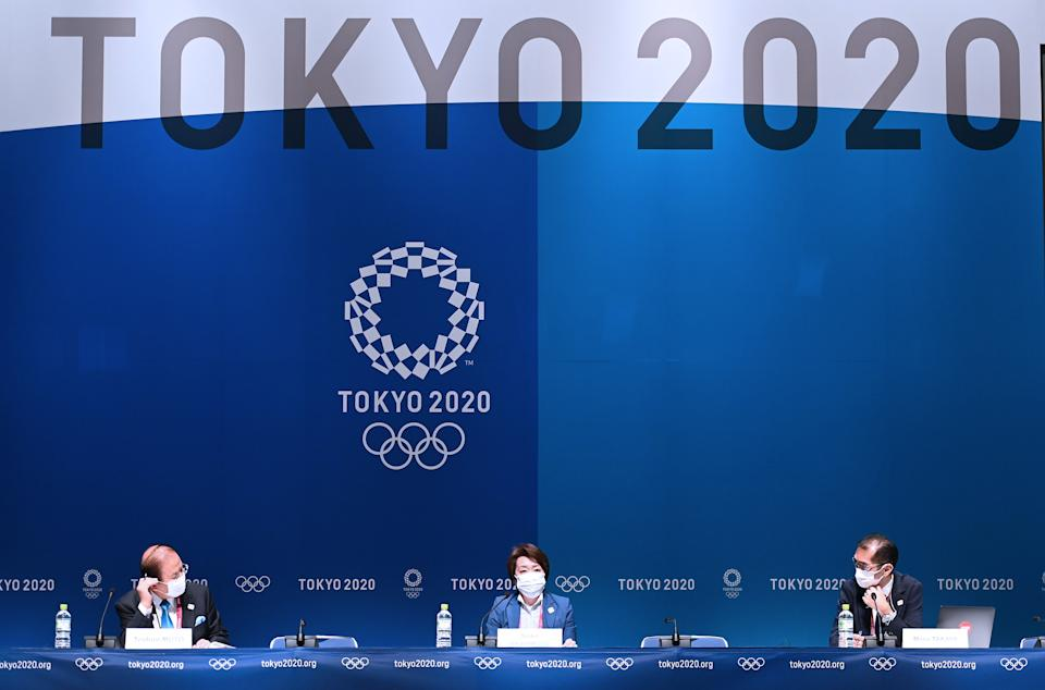 Toshiro Muto (left), head of the Tokyo Olympics organizing committee, didn't rule out canceling the Games even at this super-late stage. (Photo by He Changshan/Xinhua via Getty Images)