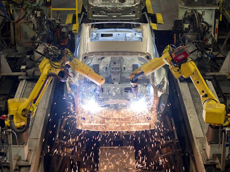 Robots weld vehicle panels at the body shop at Nissan's Sunderland plant: AFP/Getty