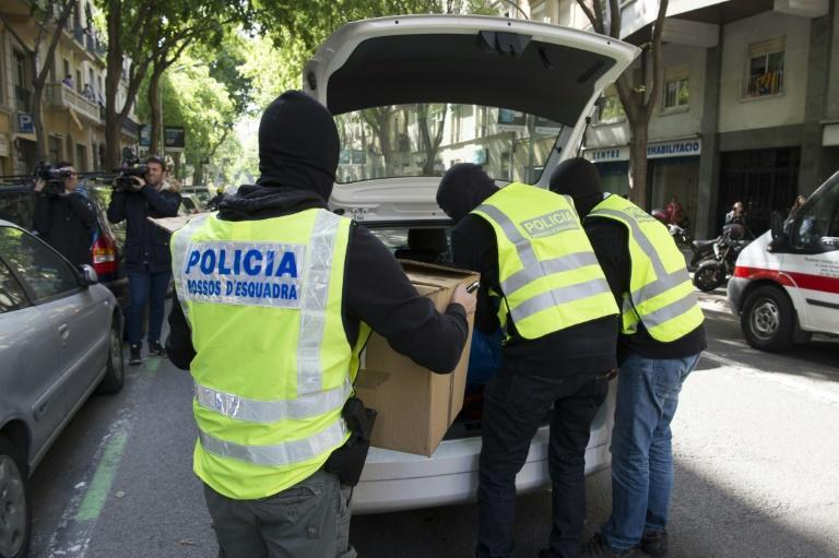 Spanish police seized firearms, drugs and cash in raids connected to a joint operation with Belgian police