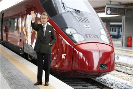 """Luca Cordero di Montezemolo, president for the NTV, waves as he poses in front of the new high-speed train """"Italo"""" at the Naples central station"""