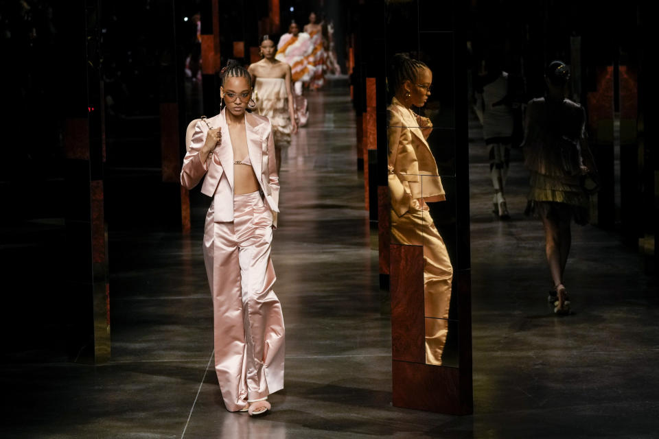 Models wear creations for the Fendi Spring Summer 2022 collection during Milan Fashion Week, in Milan, Italy, Wednesday, Sept. 22, 2021. (AP Photo/Antonio Calanni)