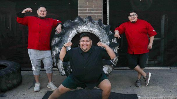 PHOTO: Abe Pena, from left, and his brothers Gustavo Pena and Rudy Pena pose for a portrait, Aug. 6, 2020, at Texas Elite Fitness in Houston. (Jon Shapley/Houston Chronicle via AP)