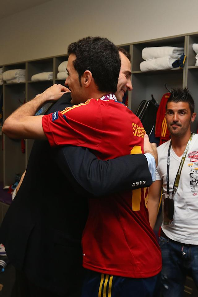 KIEV, UKRAINE - JULY 01: Prince Felipe of Spain speaks with Sergio Busquets of Spain in the dressing room following the UEFA EURO 2012 final match between Spain and Italy at the Olympic Stadium on July 1, 2012 in Kiev, Ukraine. (Photo by Handout/UEFA via Getty Images)
