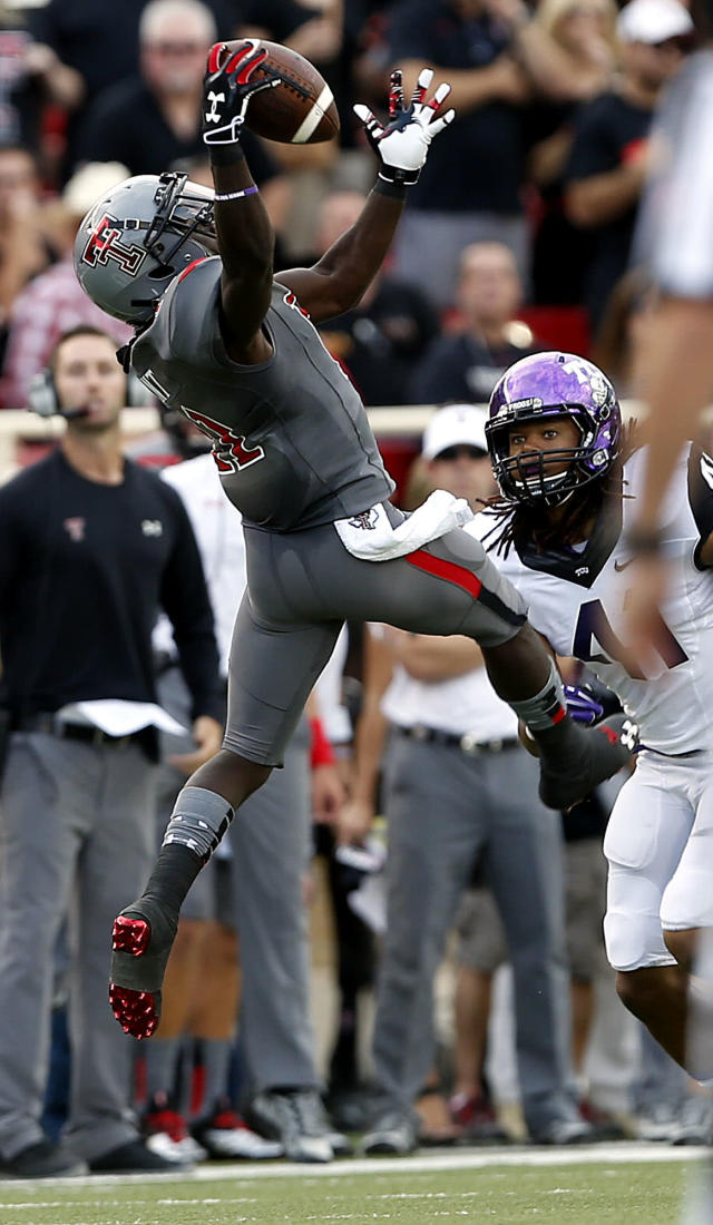 Texas Tech's Jakeem Grant pulls down a reception over TCU's Jonathan Anderson during their NCAA college football game in Lubbock, Texas, Thursday, Sept. 12, 2013. (AP Photo/Lubbock Avalanche-Journal, Stephen Spillman)