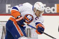FILE - In this Feb. 18, 2021, file photo, New York Islanders' Anders Lee (27) plays against the Pittsburgh Penguins during an NHL hockey game in Pittsburgh. (AP Photo/Keith Srakocic, File)