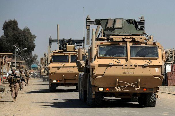 PHOTO: U.S. Marines walk during a patrol as a convoy of Mine-Resistant Ambush Protected Vehicles heads to Forward Operating Base Delhi in Garmser, Helmand Province, Afghanistan, on March 13, 2011. (Adek Berry/AFP via Getty Images, FILE)