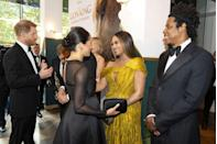 <p>Meghan meets Beyoncé and Jay-Z during the premiere for <em>The Lion King</em>.</p>