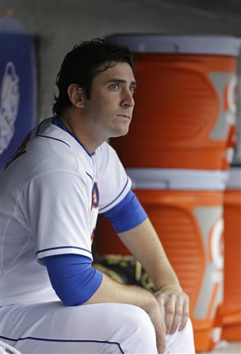 New York Mets starting pitcher Matt Harvey sits in the dugout in the seventh-inning of a 2-1 loss to the St. Louis Cardinals in a baseball game in New York, Thursday, June 13, 2013. (AP Photo/Kathy Willens)