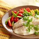 <p>Baked tilapia fillets are served alongside curry-flavored lentils, pea pods, and cherry tomatoes in this colorful and healthy 25-minute dinner recipe. With a few substitutions you can turn this dish into a sandwich or a bowl (see recipe variations, below).</p>