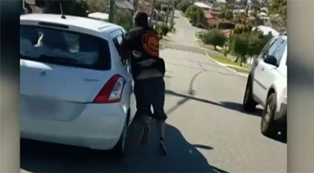 A man thrusts his arm through the window of a car in Scarborough. Source: 7 News