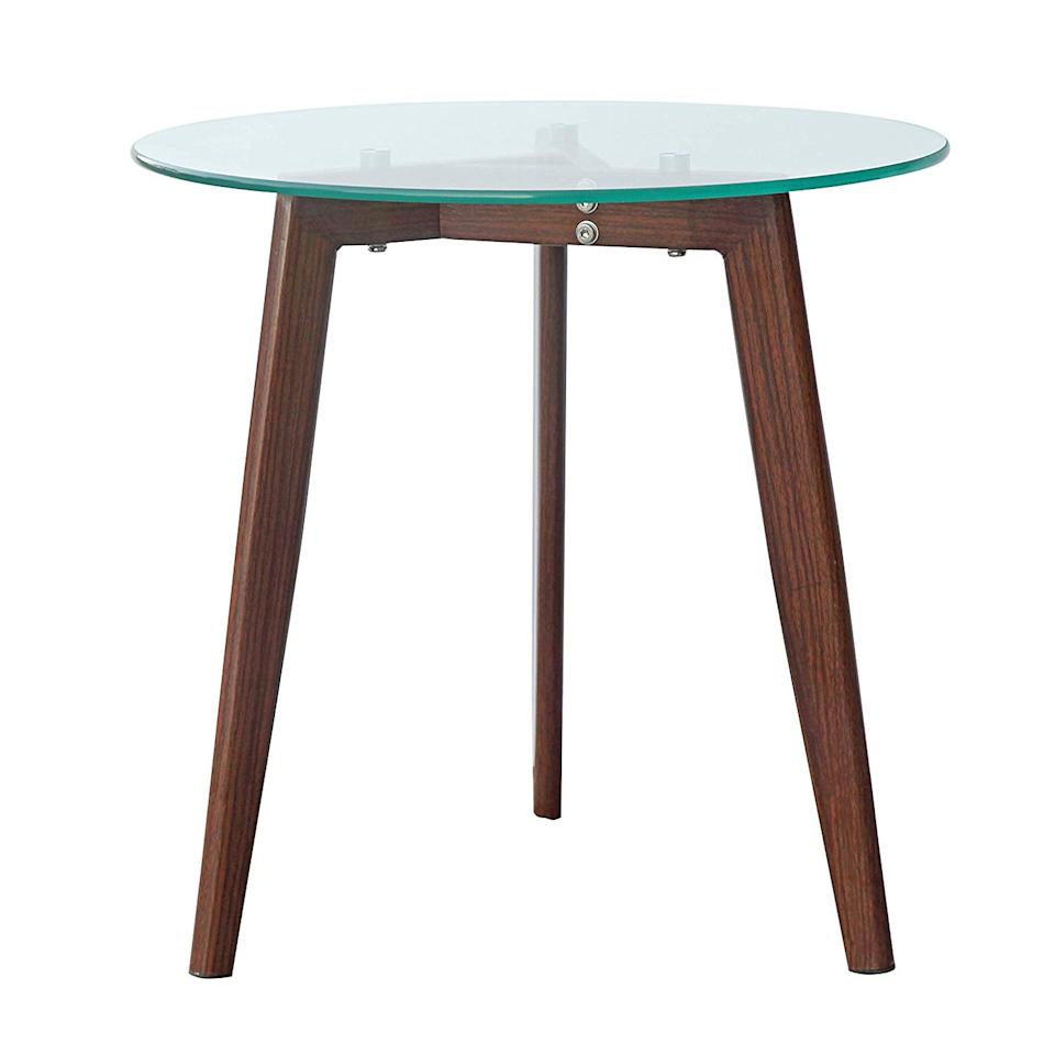 "<p>Looking for something minimal? Snag this <a href=""https://www.popsugar.com/buy/Poly-amp-Bark-Triskele-End-Table-539089?p_name=Poly%20%26amp%3B%20Bark%20Triskele%20End%20Table&retailer=amazon.com&pid=539089&price=52&evar1=casa%3Aus&evar9=46356293&evar98=https%3A%2F%2Fwww.popsugar.com%2Fphoto-gallery%2F46356293%2Fimage%2F47093722%2FLove-This-End-Table&list1=shopping%2Camazon%2Cfurniture%2Cbedrooms%2Chome%20shopping&prop13=api&pdata=1"" rel=""nofollow"" data-shoppable-link=""1"" target=""_blank"" class=""ga-track"" data-ga-category=""Related"" data-ga-label=""https://www.amazon.com/POLY-BARK-EM-280-WAL-Triskele-Walnut/dp/B077S4LY3T?ref_=ast_sto_dp&amp;th=1&amp;psc=1"" data-ga-action=""In-Line Links"">Poly &amp; Bark Triskele End Table</a> ($52).</p>"