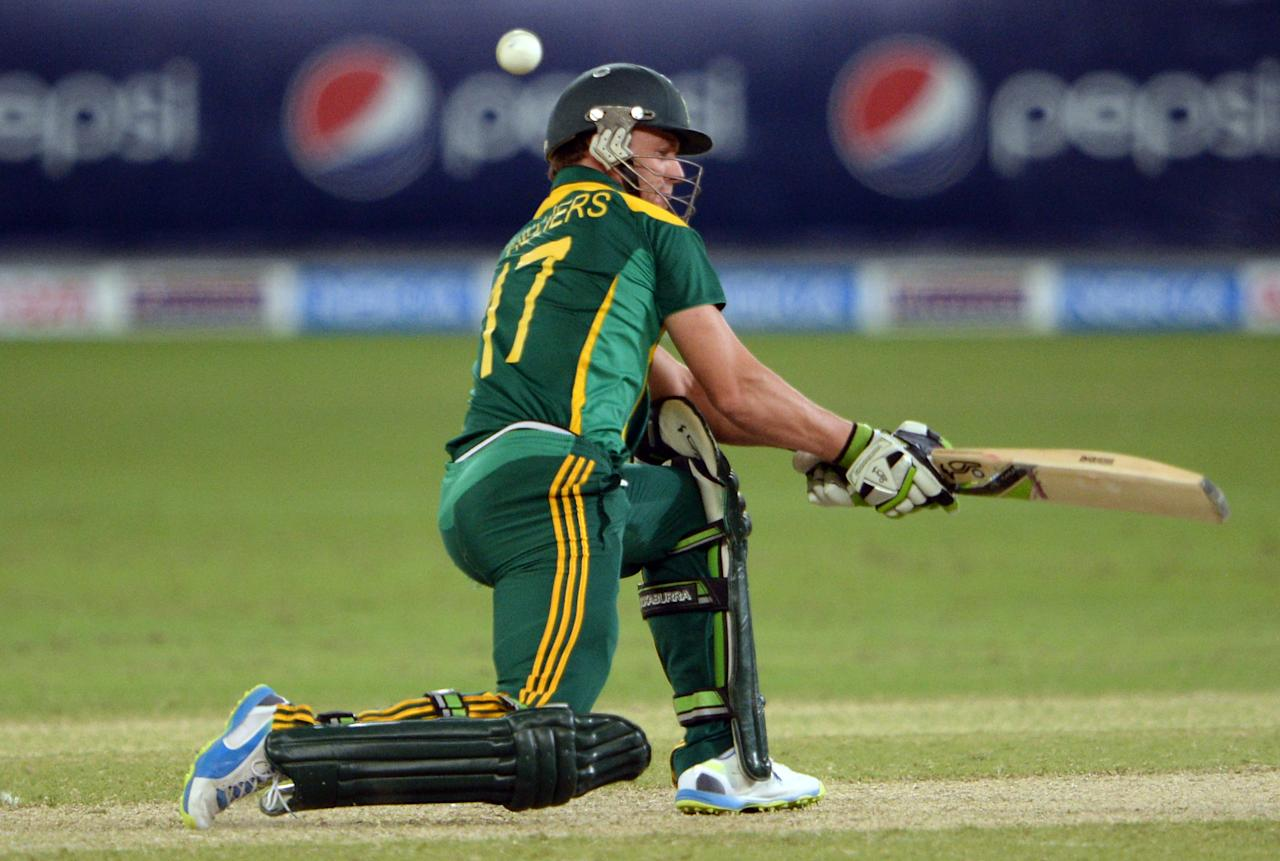 South African captain AB de Villiers sweep shots during the second day-night international against South Africa in Dubai Cricket Stadium in Dubai on November 1, 2013. Pakistan were bowled out for 209 in their innings. South Africa lead the five-match series 1-0. AFP PHOTO/ Asif HASSAN        (Photo credit should read ASIF HASSAN/AFP/Getty Images)
