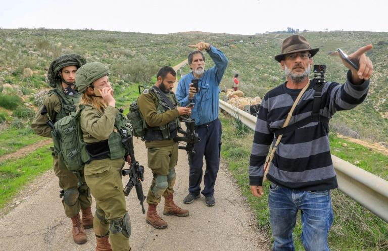 Israeli activists Guy Hirschfeld (R) and Rabbi Arik Ascherman regularly accompany Palestinian farmers in sensitive areas of the West Bank (AFP Photo/Emmanuel DUNAND)