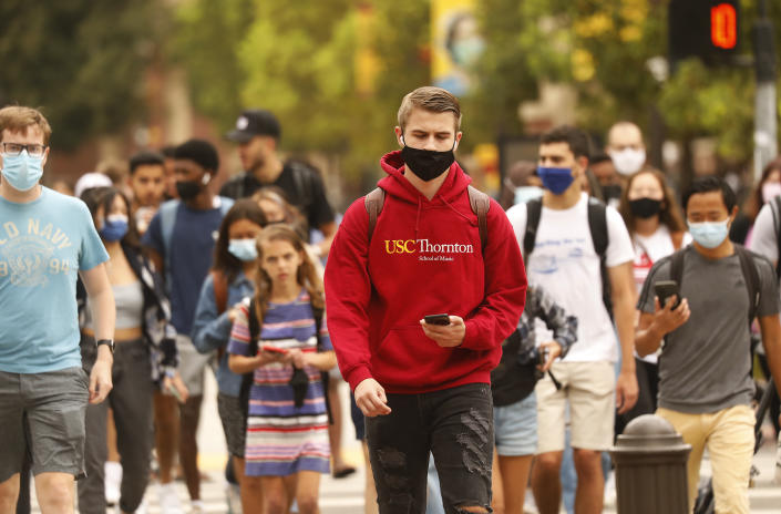 USC students, faculty and visitors use their phones to display their