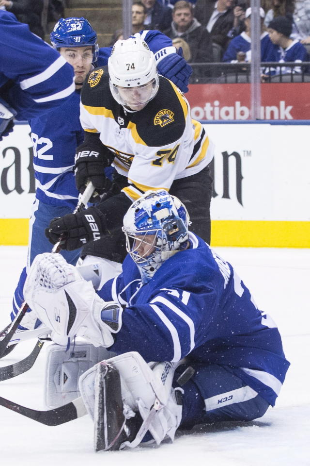 Toronto Maple Leafs goaltender Frederik Andersen (31) makes a save in front of Boston Bruins' Jake DeBrusk (74) during third-period NHL hockey game action in Toronto, Monday, Nov. 26, 2018. (Chris Young/The Canadian Press via AP)