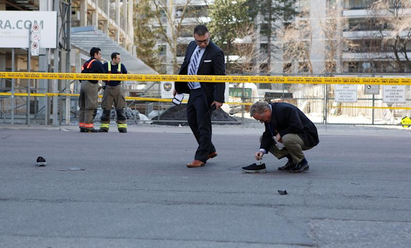 Toronto police investigate the scene of the crash.
