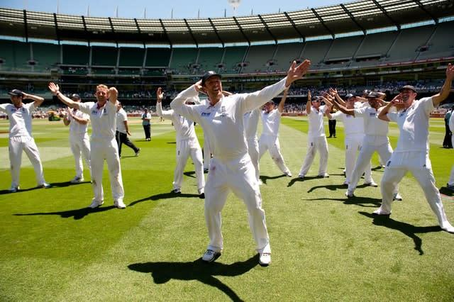 England's players celebrate by doing the sprinkler dance after victory at the MCG (Gareth Copley/PA)