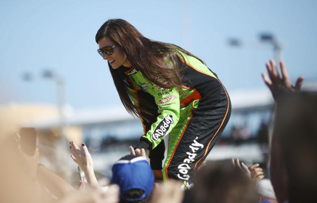 Danica Patrick greets fans before the NASCAR Sprint Cup Series auto race in Homestead, Fla., Sunday, Nov. 17, 2013. (AP Photo/J Pat Carter)