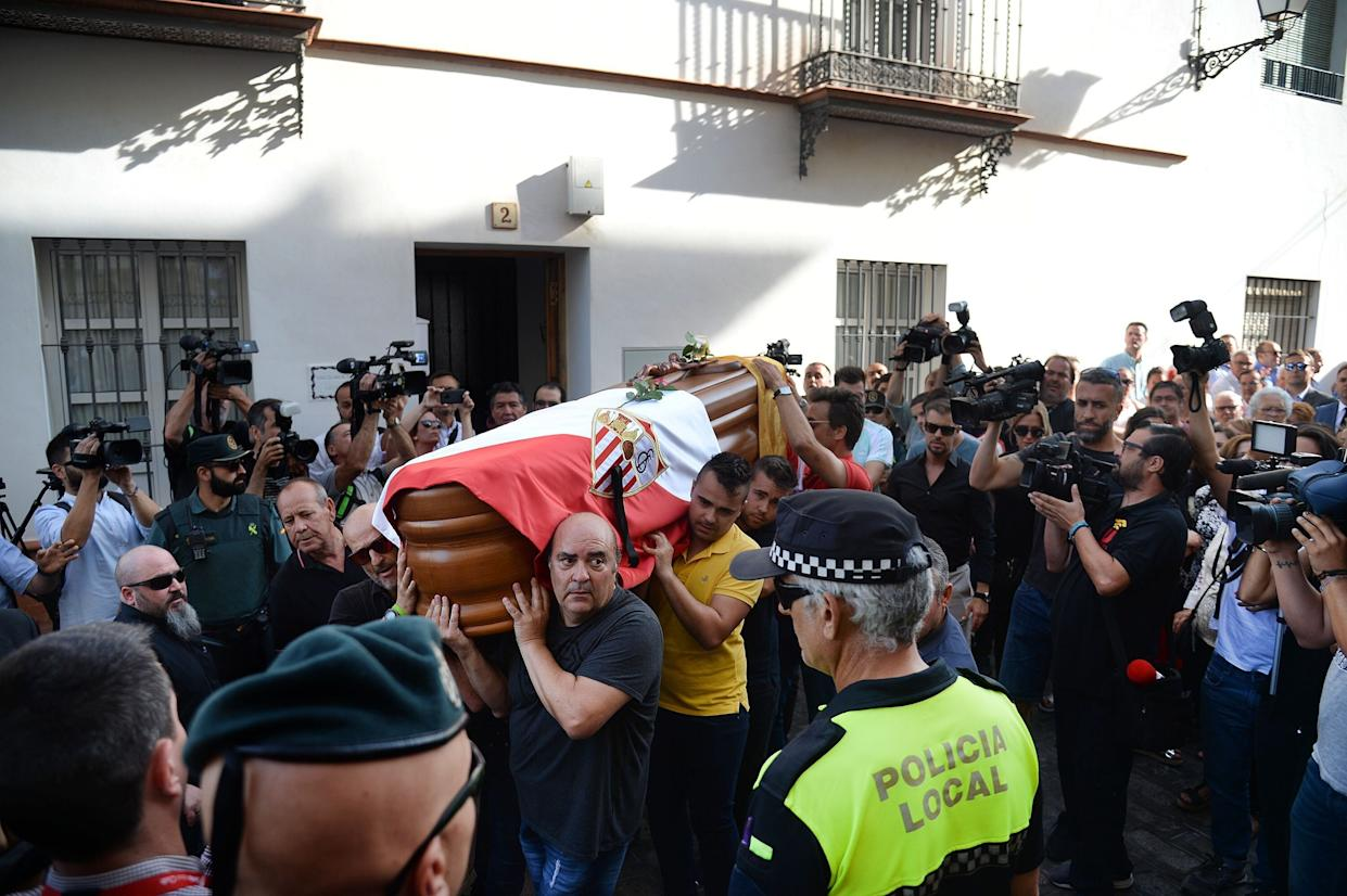 The coffin with the remains of Spanish football player Jose Antonio Reyes is carried on shoulders to the Santa Maria de Mesa church in Utrera, Seville during the funeral for the footballer on June 3, 2019. - Former Arsenal, Real Madrid and Spain forward, Jose Antonio Reyes, 35, was killed in a car crash on June 1, 2019. Reyes shot to fame at Sevilla and secured a switch to Arsenal, where he was part of the unbeaten 'Invincibles' 2003-2004 Premier League winners, before spells at Real and Atletico Madrid. (Photo by CRISTINA QUICLER / AFP)        (Photo credit should read CRISTINA QUICLER/AFP/Getty Images)