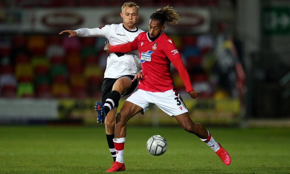 Jamie Reckord of Wrexham (right) battles for possession with Sam Barratt of Maidenhead during October's National League game.
